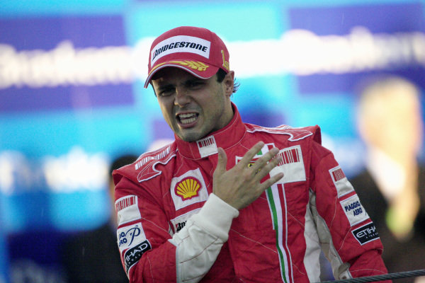 An emotional Felipe Massa proudly slaps the Prancing Horse insignia on his chest as he celebrates victory and a well fought season in front of his home fans.