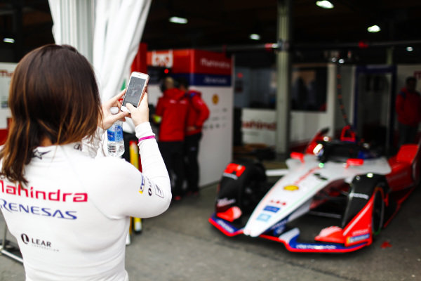 Katherine Legge (GBR), Mahindra Racing, takes a picture of her car in the garage
