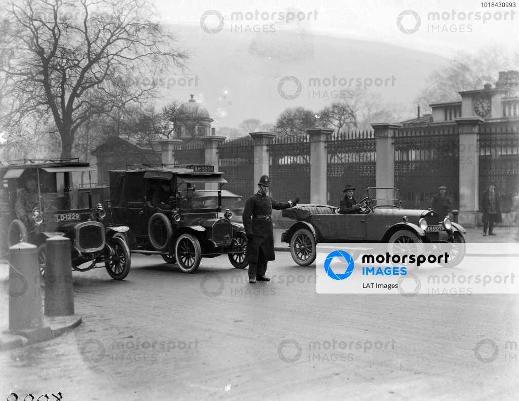 Studebaker 6 cylinder in London with a policeman directing traffic