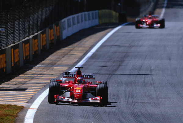 2002 Brazilian Grand Prix, Interlagos, Brazil.29th - 31st March 2002.Rubens Barrichello sprints away from Michael Schumacher as he runs a lighter fuel load in the old 2001 Ferrari Chassis.World Copyright: Rose/ LAT PhotographicRef: 35mm Transparency A16