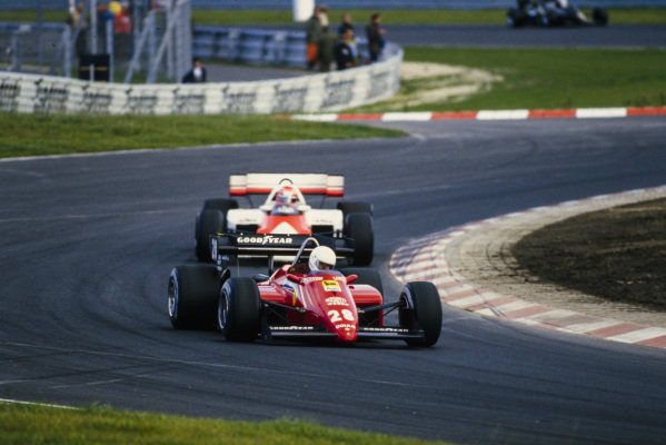 René Arnoux, Ferrari 126C4, leads Niki Lauda, McLaren MP4-2 TAG.