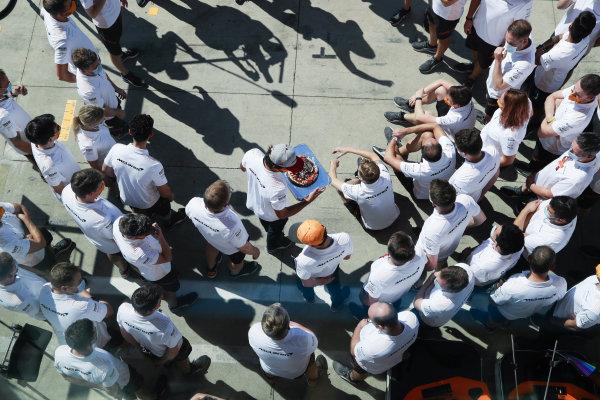 Carlos Sainz, McLaren, with birthday cake