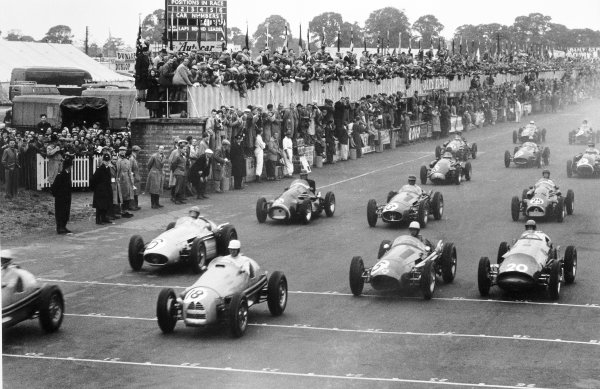 "1954 British Grand Prix Silverstone, Great Britain. 17 July 1954 With the leaders gone Clemar Bucci, Gordini 16 #18, retired, ""B Bira"", Maserati 250F #6, retired, Roy Salvadori, Maserati 250F #5, retired, and Peter Collins, Vanwall Special #20, retired, take the start. Bill Whitehouse, Connaught A-Lea-Francis, retired, Onofre Marimon, Maserati 250F, 3rd position, and Don Beauman, Connaught A-Lea-Francis, 11th position, follow, action World Copyright: LAT PhotographicRef: Autosport b&w print"