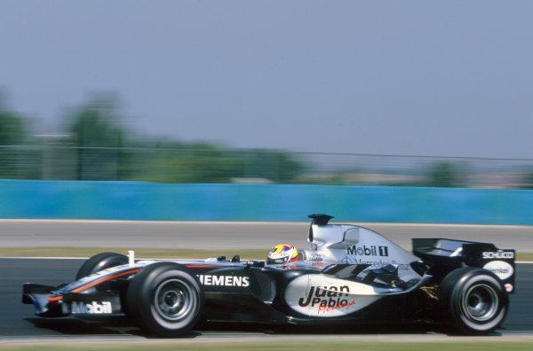 2005 Hungarian Grand Prix. Hungaroring, Hungary. 29th - 31st July 2005 Juan Pablo Montoya, McLaren Mercedes MP4-20. Action. World Copyright: Lorenzo Bellanca/LAT Photographic Ref: 35mm Image A07