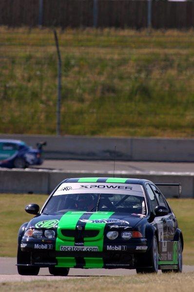Warren Hughes (GBR) MG Sport and Racing.British Touring Car Championship, Rd 5, Rockingham, England, 21-22 June 2003.DIGITAL IMAGE