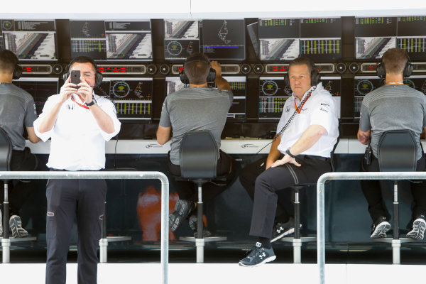 Yas Marina Circuit, Abu Dhabi, United Arab Emirates. Saturday 25 November 2017. Eric Boullier, Racing Director, McLaren and Zak Brown, Executive Director, McLaren Technology Group on the pit wall. World Copyright: Steven Tee/LAT Images  ref: Digital Image _R3I3387