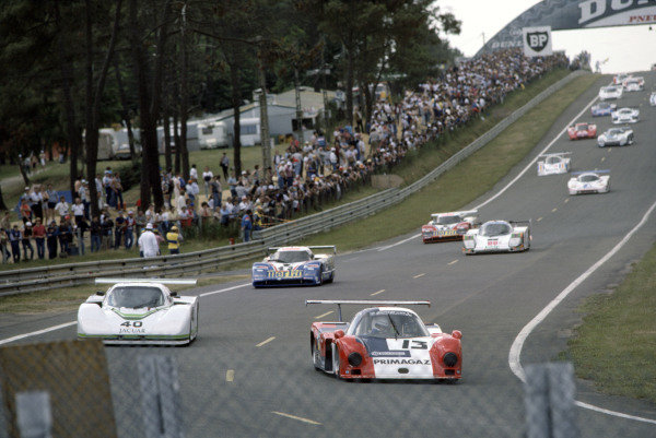 1985 Le Mans 24 HoursLe Mans, France. 15th - 16th June.Yves Courage/Alain de Cadenet/Jean-Francois Yvon (Cougar C12-Porsche) leads Brian Redman/Hurley Haywood/Jim Adams (Jaguar XJR-5).World Copyright: Murenbeeld/LAT Photographicref: 35mm Transparency Image