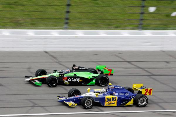 30 April - 1 May, 2010, Kansas City, Kansas, USADanica Patrick races with Mike Conway.©2010 Phillip Abbott, USALAT Photographic