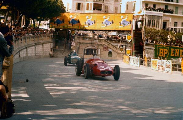 Monte Carlo, Monaco. 16-19 May 1957. Harry Schell/Giorgio Scarlatti (Maserati 250F) leads Stirling Moss (Vanwall VW3) out of Tabac corner. Ref-57 MON 18. World Copyright - LAT Photographic