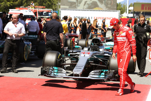 Circuit de Catalunya, Barcelona, Spain. Saturday 13 May 2017. Sebastian Vettel, Ferrari, checks out the car of Lewis Hamilton, Mercedes F1 W08 EQ Power+, in Parc Ferme. World Copyright: Charles Coates/LAT Images ref: Digital Image DJ5R8914