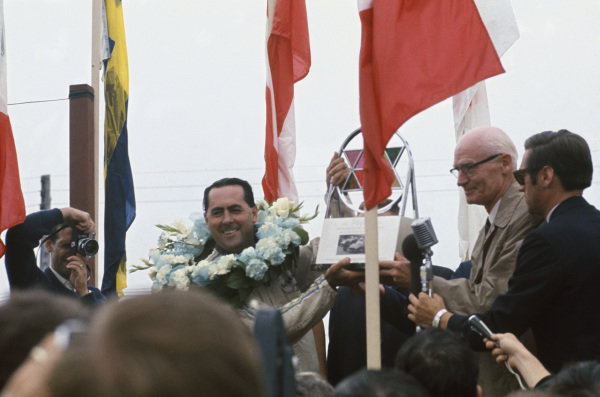 Mosport Park, Ontario, Canada.  25-27 August 1967.  Jack Brabham (Brabham BT24-Repco) celebrates victory on the podium, portrait.  World Copyright: LAT Photographic. Ref:  67CAN08