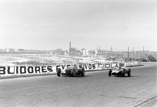 1960 Portuguese Grand Prix Oporto, Portugal. 12-14 August 1960 Jack Brabham (#2 Cooper T53-Climax) passes Wolfgang von Trips (Ferrari Dino 246). They finished in 1st and 4th position respectively World Copyright: LAT PhotographicRef: Autosport b&w print