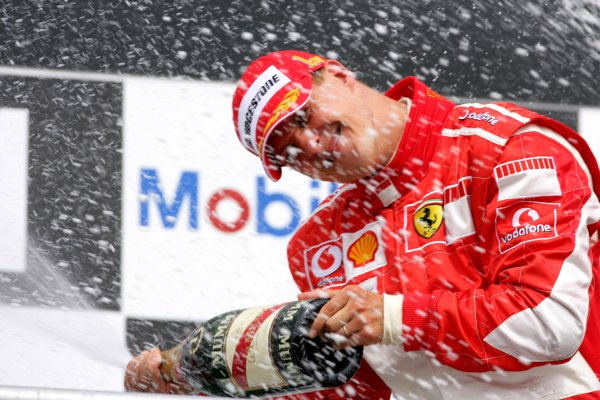 2006 German Grand Prix - Sunday Race Hockenheim, Germany. 27th - 30th July. Michael Schumacher (1st position), Ferrari, celebrates on the podium. World Copyright: Lorenzo Bellanca/LAT Photographic ref: Digital Image ZD2J2123