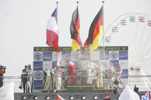 2006 Le Mans 24 Hours, Le Mans, France.14th - 18th June. LMPI Podium. F Biela (DEU)/ E Pirro (ITA)/ M Werner (DEU), Audi Sport Team Joest. and E Helary (FRA)/ S Loeb (FRA)/ F Montagny (FRA), Pescarolo Sport, Pescarolo Judd. and R Capello (ITA)/ T Kristensen (DNK)/ A McNish (GBR), Audi Sport Team Joest. Celebrate on the podium.World Copyright: Andrew Ferraro/LAT PhotographicRef: Digital Image Only ZP9O1526