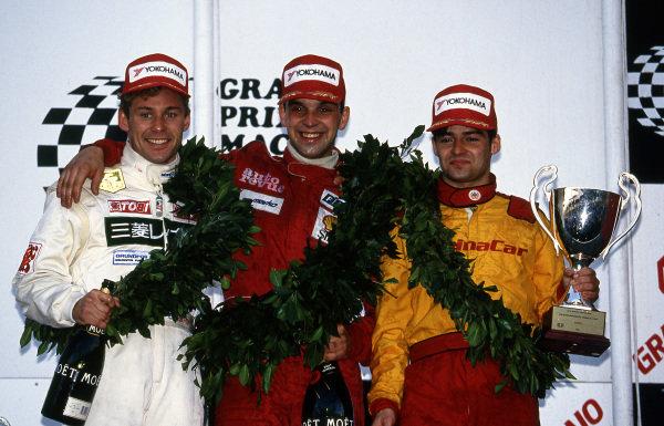 (L to R): Tom Kristensen (DEN) Toms Toyota, Jorg Muller (GER) and Kelvin Burt (GBR) celebrate on the podium at Macau Formula Three Grand Prix, Macau, Hong Kong, 21 November 1993.