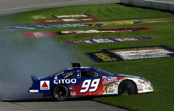 Jeff Burton (USA), CITGO Ford Taurus, spins out early but recovered to a 7th place finish. 