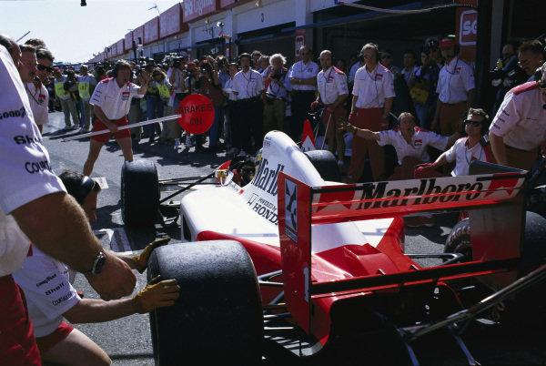 Ayrton Senna, McLaren MP4-7A Honda, during a pitstop.