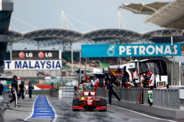 Sepang, Kuala Lumpur, Malaysia4th April 2009Kimi Raikkonen, Ferrari F60, leaves the pit lane. Action. Pit Stops. World Copyright: Charles Coates/LAT Photographicref: Digital Image _26Y6109