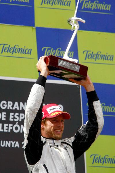 Circuit de Catalunya, Barcelona, Spain10th May 2009Winner Jenson Button, Brawn GP BGP001 Mercedes celebrates on the podium with his trophy. Portrait.World Copyright: Charles Coates/LAT Photographicref: Digital Image _26Y8629
