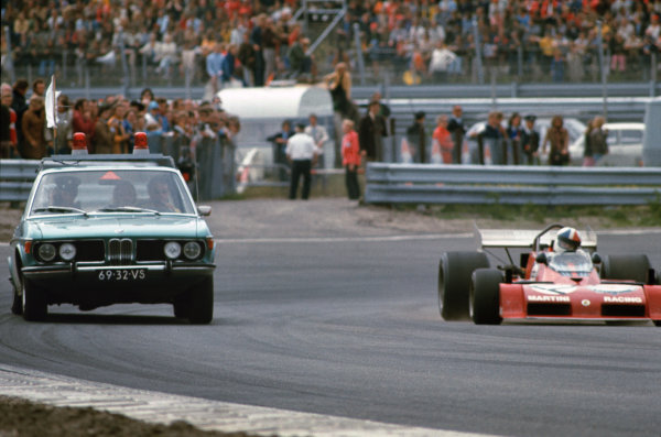 1973 Dutch Grand Prix.  Zandvoort, Netherlands. 27-29th July 1973.  Doctor's car on track with Chris Amon, Tecno PA123B, alongside.  Ref: 73HOL34. World Copyright: LAT Photographic