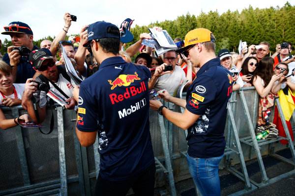 Spa Francorchamps, Belgium.  Thursday 24 August 2017. Daniel Ricciardo, Red Bull Racing, and Max Verstappen, Red Bull Racing, sign autographs for fans. World Copyright: Andy Hone/LAT Images  ref: Digital Image _ONZ8508