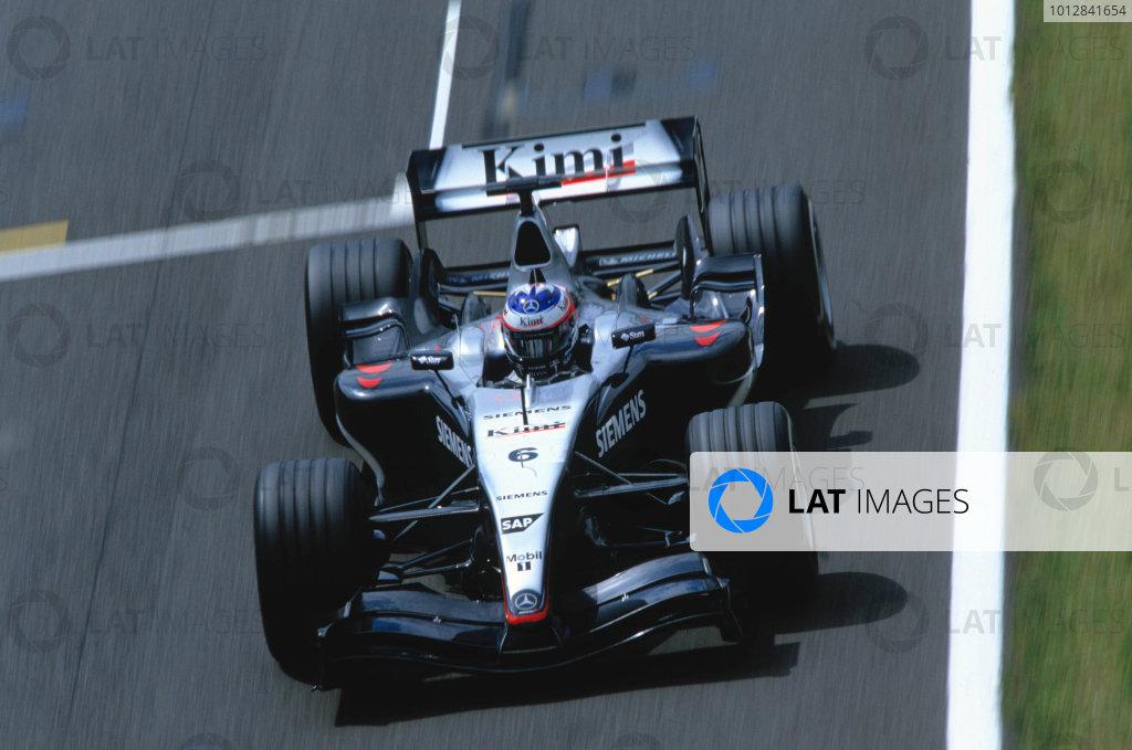 2004 British Grand PrixSilverstone England. 9th - 11th July.Kimi Raikkonen, McLaren Mercedes MP4/19. Action. World Copyright:Glenn Dunbar/LAT PhotographicRef:35mm image A01