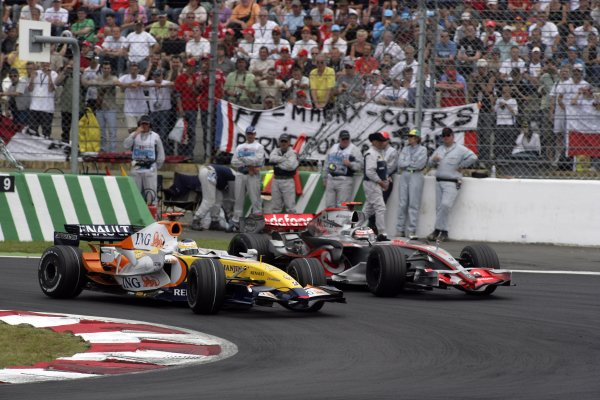 2007 French Grand Prix - Sunday RaceCircuit de Nevers Magny Cours, Nevers, France.1st July 2007.Giancarlo Fisichella, Renault R27, 6th position, leads Fernando Alonso, McLaren MP4-22 Mercedes, 7th position. Action. World Copyright: Andrew Ferraro/LAT Photographicref: Digital Image VY9E3395