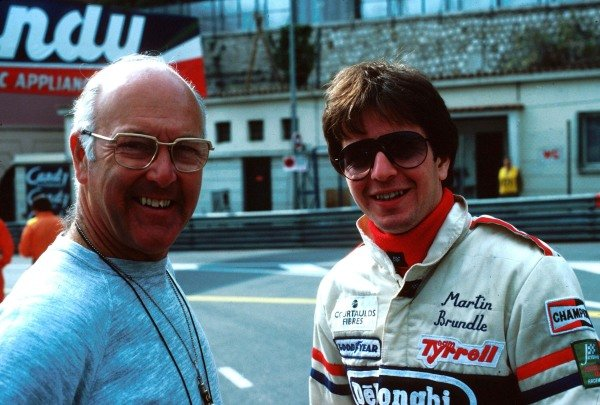 (L to R): Murray Walker (GBR) BBC Television Commentator with Martin Brundle (GBR) Tyrrell. Monaco Grand Prix, Monte Carlo, 19 May 1985.