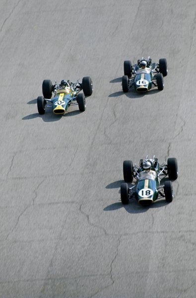 Denny Hulme (NZL) Brabham Repco BT24, leads Graham Hill (GBR) Lotus Ford 49, and Jack Brabham (AUS) Brabham Repco BT24.