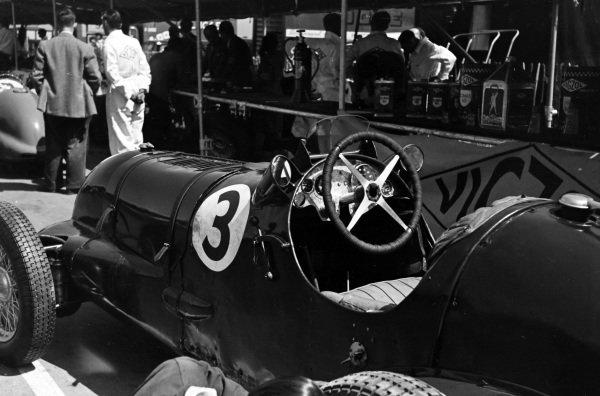 Tony Rolt's Aitken-Alfa Romeo in the pits.