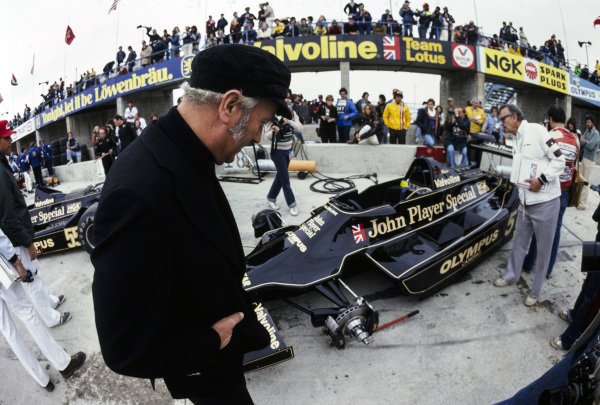 Colin Chapman with Mario Andretti's Lotus 79 Ford.