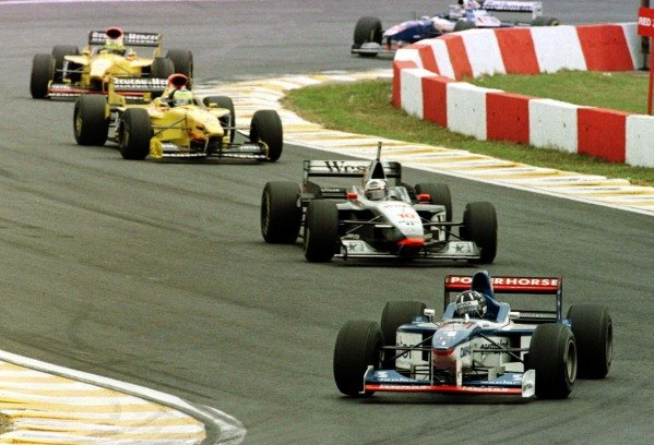 "1997 Brazilian Grand Prix.Interlagos, Sao Paulo, Brazil.28-30 March 1997.Damon Hill (Arrows A18 Yamaha) leads David Coulthard (McLaren MP4/12 Mercedes-Benz), Giancarlo Fisichella and Ralf Schumacher (both Jordan 197 Peugeot) at the start into the Senna's ""s"".World Copyright - LAT Photographic"
