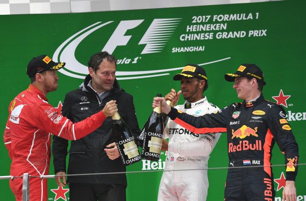 Sebastian Vettel (GER) Ferrari, Aldo Costa (ITA) Mercedes AMG F1 Engineering Director, Lewis Hamilton (GBR) Mercedes AMG F1 and Max Verstappen (NED) Red Bull Racing celebrate on the podium with the champagne at Formula One World Championship, Rd2, Chinese Grand Prix, Race, Shanghai, China, Sunday 9 April 2017.