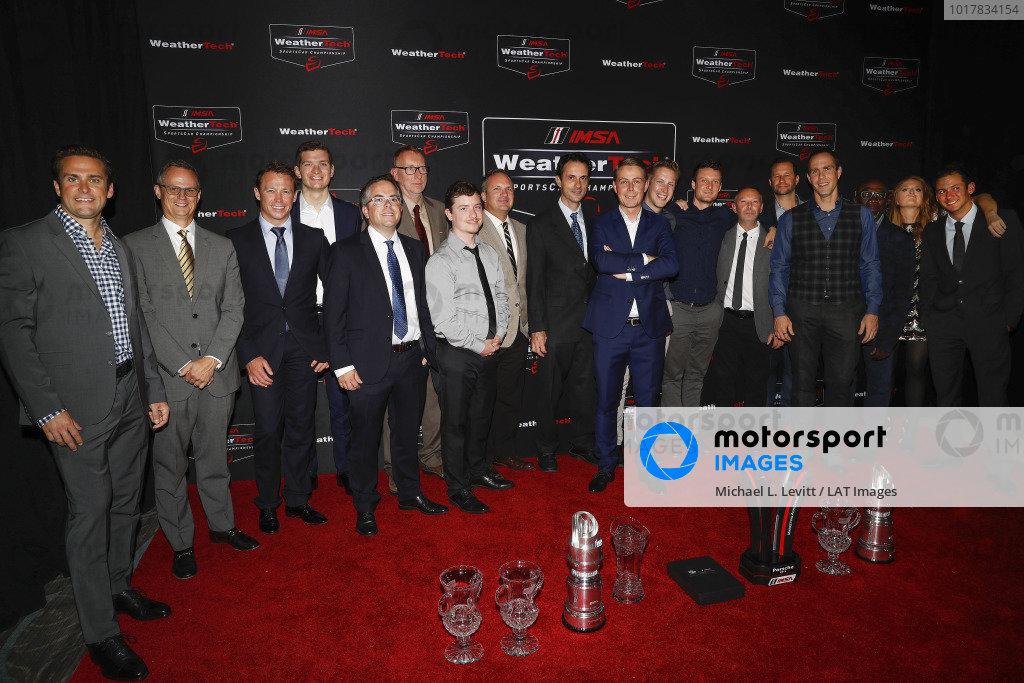 #912 Porsche GT Team Porsche 911 RSR, GTLM: Earl Bamber, Laurens Vanthoor, #911 Porsche GT Team Porsche 911 RSR, GTLM: Patrick Pilet, Nick Tandy, with Porsche personnel and trophies