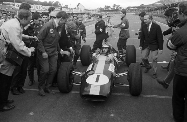 Jim Clark, Lotus 25 Climax, after the race. Colin Chapman is beside.