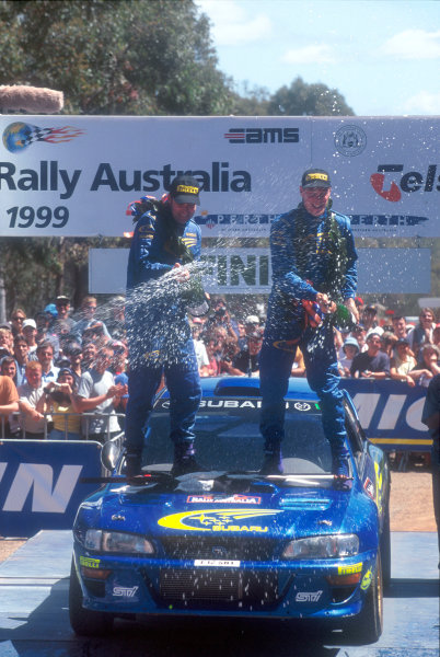 1999 World Rally Championship Rally Australia. 4th - 7th November 1999. Rally winner Richard Burns, Subaru Impreza, podium. World Copyright: McKlein/LAT Photographic