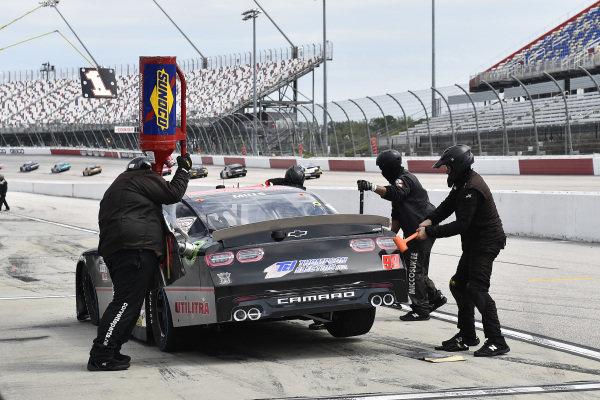 #99: Matt Mills, B.J. McLeod Motorsports, Chevrolet Camaro JF Electric pit stop