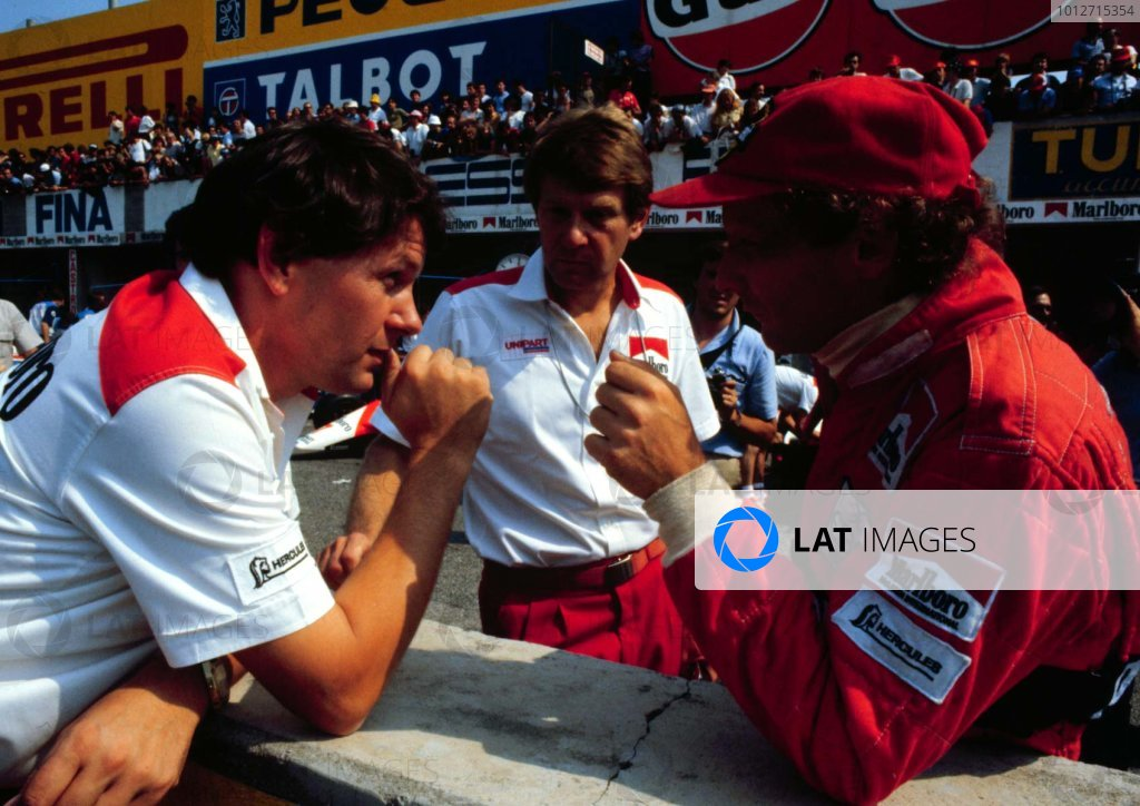 1982 Italian Grand Prix, Monza, Italy.10-12 September 1982.McLaren chief designer John Barnard talks with his driver Niki Lauda before the race. 