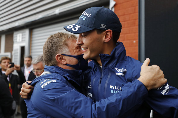 George Russell, Williams, celebrates with Jost Capito, CEO, Williams, after securing second position in Qualifying