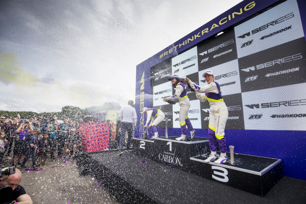Beitske Visser (NLD), Jamie Chadwick (GBR) and Alice Powell (GBR) celebrate on the podium with the Champagne