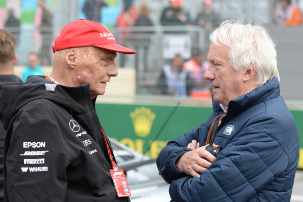 Niki Lauda (AUT) Mercedes AMG F1 Non-Executive Chairman and Charlie Whiting (GBR) FIA Delegate on the grid