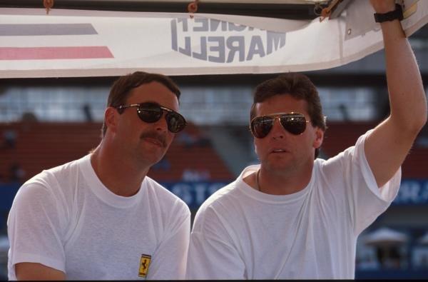 Nigel Mansell and fellow Brit Derek Warwick talk German GP, Hockenheim, Germany, 29 July 1990