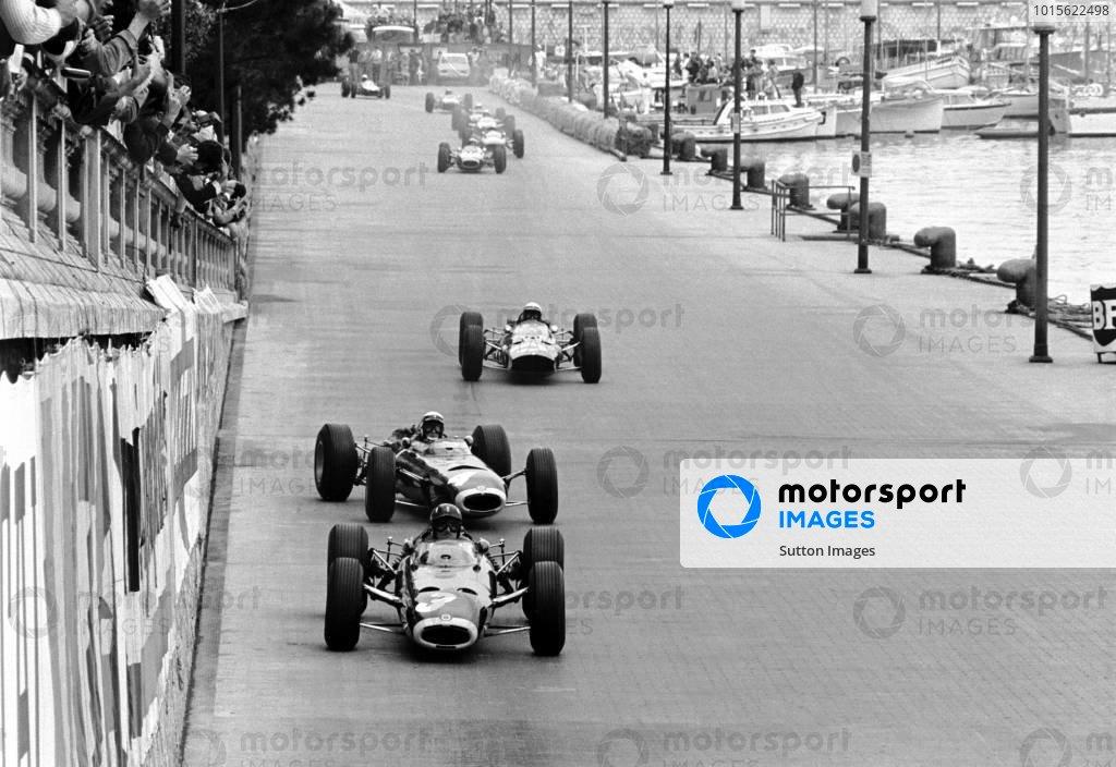 Monaco GP   30 May 1965  Lap 1:  Winner Graham Hill BRM P261 leads a sideways Jackie Stewart(3rd) BRM P261 and Lorenzo Bandini(2nd Ferrari 1512