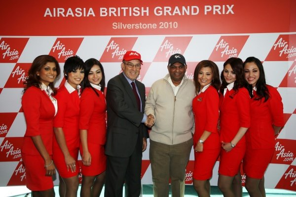 L-R: Carmelo Ezpeleta (ESP) CEO Dorna Sports S.L. and Tony Fernandes (MAL), CEO AirAsia Group, shake hands after exchanging contracts.AirAsia Signs As Title Sponsor for 2010 MotoGP British Grand Prix, Silverstone, England, Wednesday 10 February 2010.