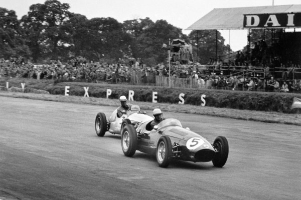 1954 British Grand Prix Silverstone, Great Britain. 17 July 1954 Roy Salvadori, Maserati 250F, retired, leads Harry Schell, Maserati 250F, 12th position, action World Copyright: LAT PhotographicRef: Autosport b&W print