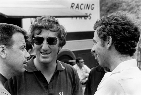 Charade, Clermont-Ferrand, France. 4-6 July 1969.Jochen Rindt (Lotus 49B-Ford Cosworth), 1st position, chats with Goodyear tyre boss Leo Mehl and Piers Courage, portrait.World Copyright: LAT Photographic.Ref: 1064A - 8/8A.