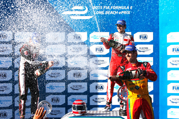 2014/2015 FIA Formula E Championship. Long Beach ePrix, Long Beach, California, United States of America. Sunday 5 April 2015 Podium. Nelson Piquet Jr (BRA)/China Racing - Spark-Renault SRT_01E, first, Jean-Eric Vergne (FRA)/Andretti Motorsport - Spark-Renault SRT_01E, second and Lucas di Grassi (BRA)/Audi Abt Sport - Spark-Renault SRT_01E, third. Photo: Zak Mauger/LAT/Formula E ref: Digital Image _L0U8755