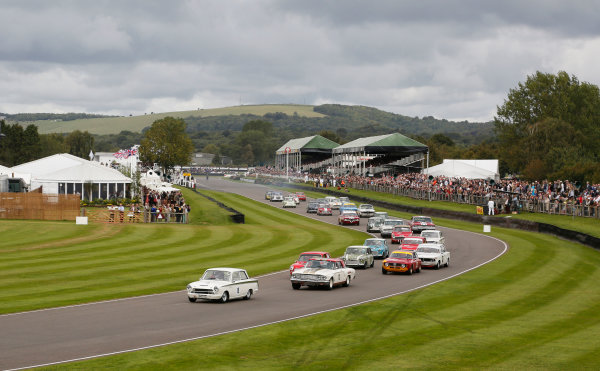 2015 Goodwood Revival Meeting.  Goodwood Estate, West Sussex, England. 11th - 13th September 2015.  St. Mary's Trophy.  Matt Neal, Ford Lotus Cortina, leads Henry Mann, Ford Fairlane Thunderbolt, as the field heads into Madgwick corner at the start.  Ref: _W5_5776. World copyright: Kevin Wood/LAT Photographic