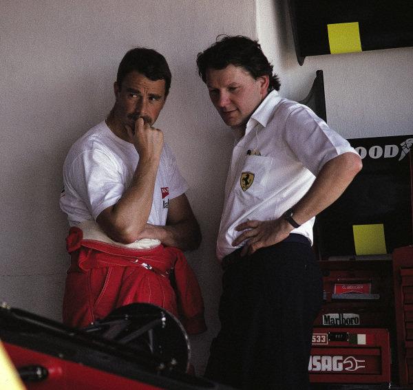 Nigel Mansell and John Barnard in the Ferrari garage.