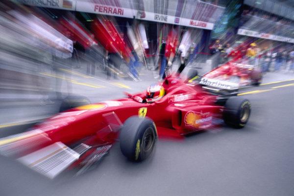 Michael Schumacher, Ferrari F310, in the pitlane.